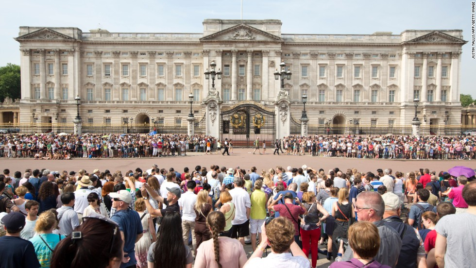 Crowds gather outside Buckingham Palace in London as news of Catherine, Duchess of Cambridge's, labor arrives on July 22.