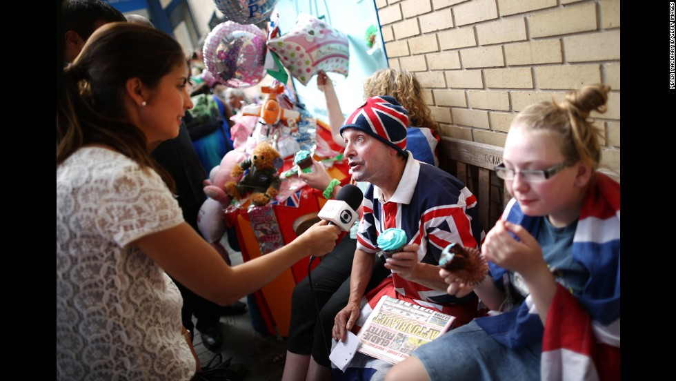 Royal supporters are interviewed by a television crew outside St. Mary's Hospital on July 22.