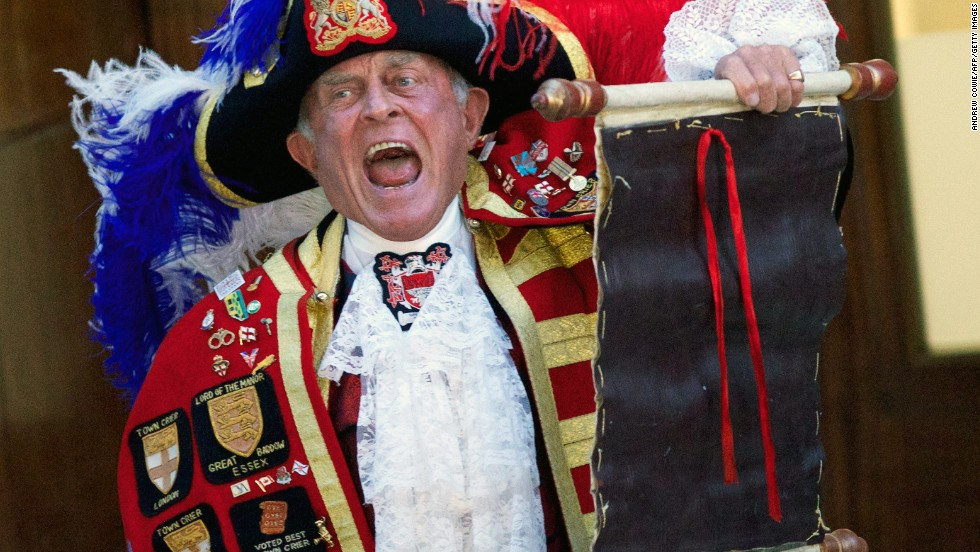 A town crier reads the announcement of the birth outside the Lindo Wing of St. Mary's Hospital in London on July 22.