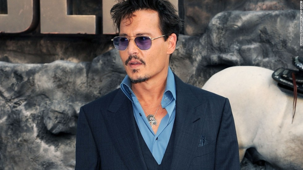 "Johnny Depp attends the UK Premiere of ""The Lone Ranger"" at Odeon Leicester Square in London, England."