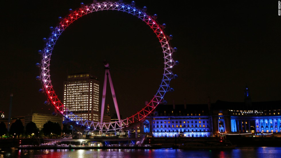 The London Eye Ferris wheel on the banks of the Thames is lit up in red, blue and white to mark the birth of the boy on July 22.