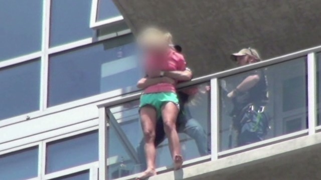 dnt stuntmen rescue woman from ledge_00011309.jpg