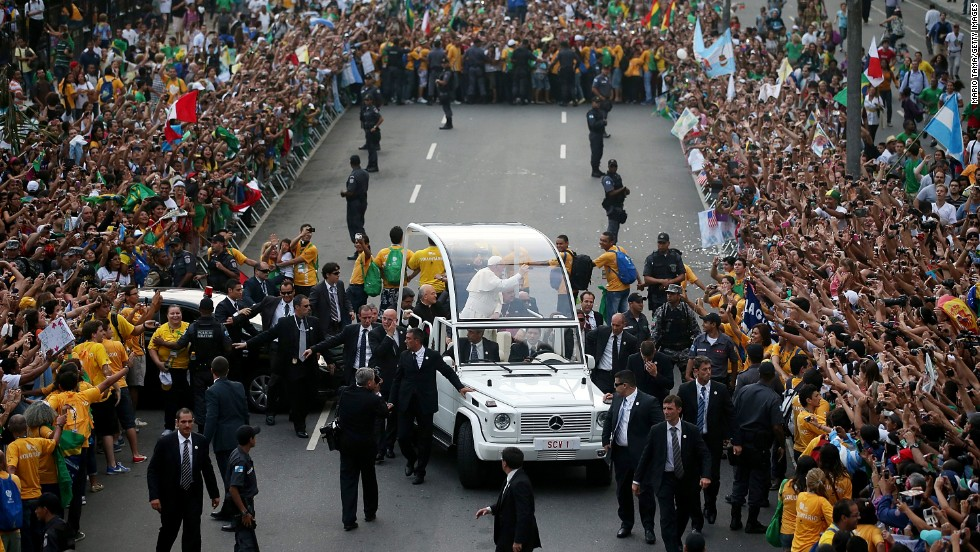 A crowd surrounds the Popemobile on July 22 as Pope Francis departs the Metropolitan Cathedral.