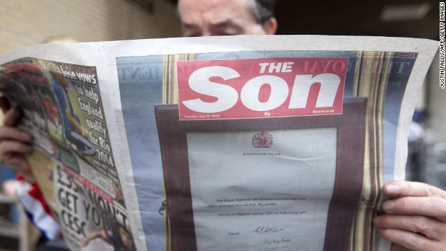 A man reads a copy of British tabloid The Sun, today re-named 'The Son', on July 23.