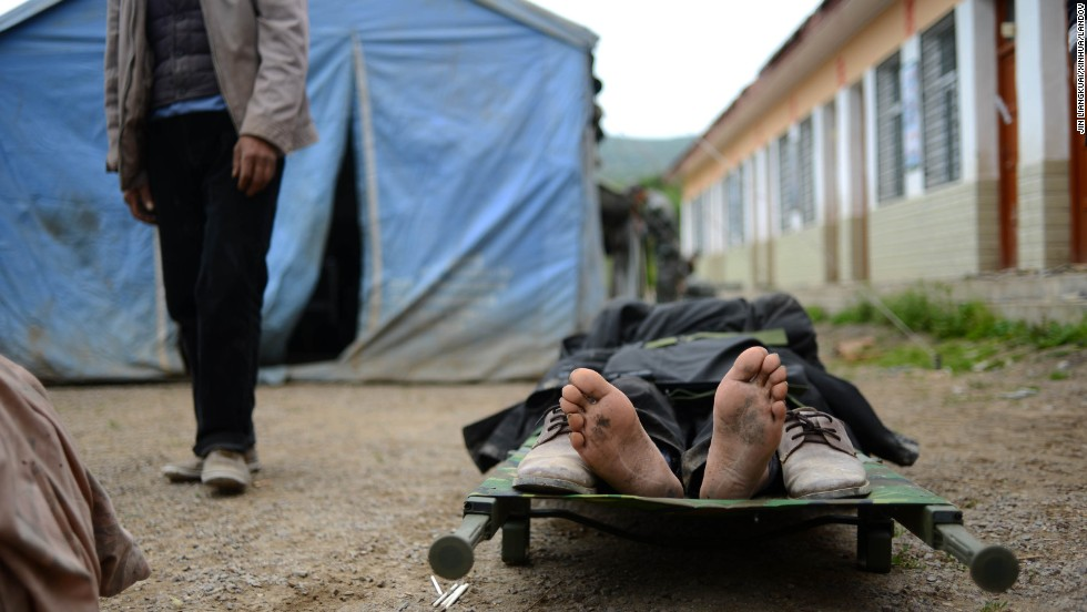 An injured person waits for treatment in Yongxing on July 23.