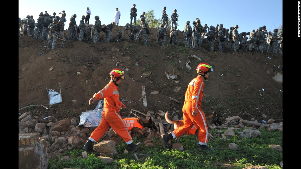 Rescuers search for victims in Yongguang on July 23.