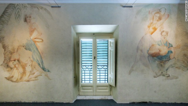 Frescos in Benito Mussolini's Rome residence, where the fascist dictator installed a tennis court and screened films.