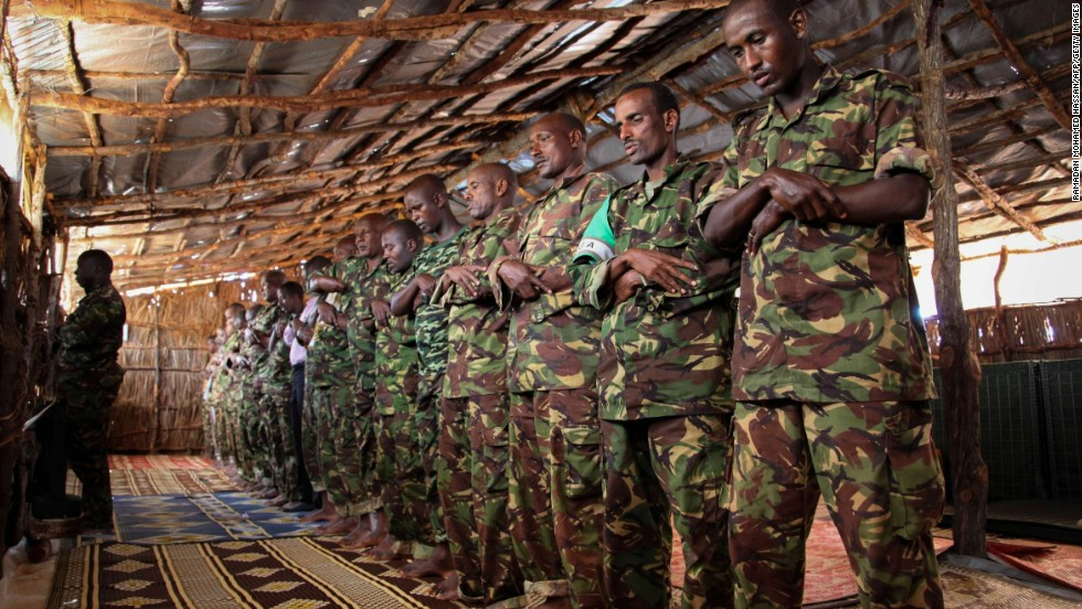 Muslim soldiers from the Kenyan Contingent serving with the African Union Mission in Somalia  pray on July 16 inside a military base near the southern Somali port city of Kismayo .