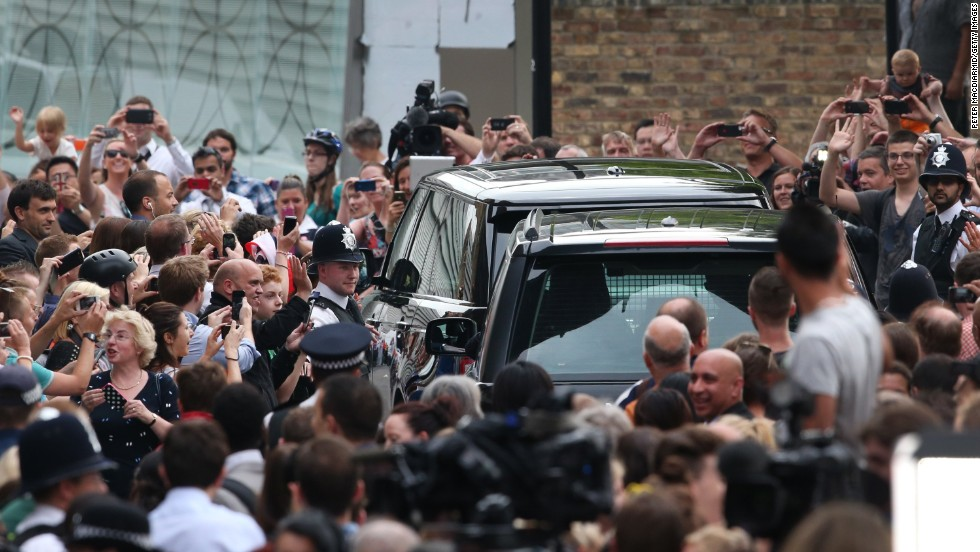 Well-wishers see the royal couple off after getting a glimpse of the newest heir to the British throne.