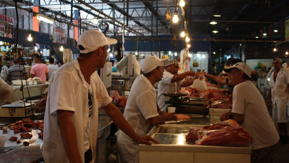 A busy fish market in Manaus, a city that consumes more fish per person per year than the entire rest of Brazil, and includes fish from the Rio Negro and Amazon Rivers not found in any other part of the world.