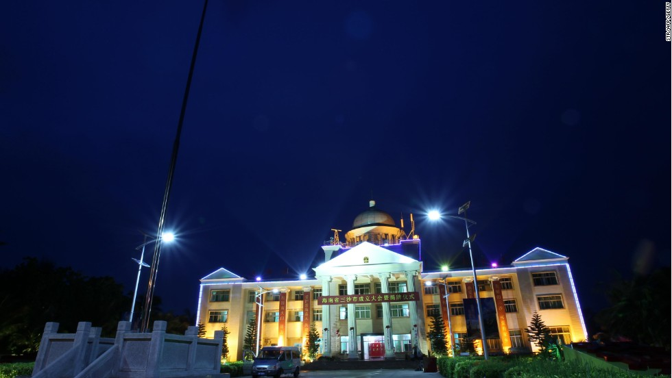 A Chinese government house glows at nighttime in the new island city of Sansha in Hainan province. The city is on Yongxing, one of many small islands, reefs and shoals in the South China Sea.