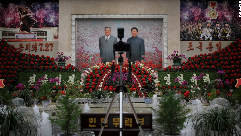 A mosaic of the late leaders Kim Il Sung and Kim Jong Il is on display at an exhibition in Pyongyang on July 24.