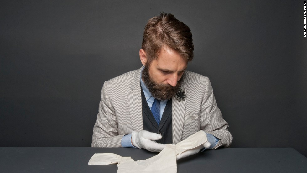 """Timothy Long, Curator of Fashion and Decorative Arts, says: """"Through exploring these objects belonging to former royal babies, we are not only able to bring to life a very personal family story, yet we are also able to connect the newest generation of the royal family to over 400 years of UK history.""""<br /><br />Here, Long delicately handles a linen undershirt (or vest as its known in Britain) with a crown embroidery worn by Prince George William Frederick, who later became King George III, in 1738. He reigned as King from 1760-1820, including during the American Revolution."""