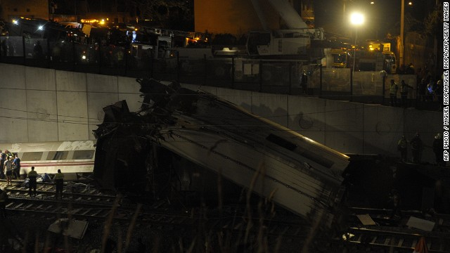 A picture taken on July 24, 2013 shows derailed cars on the site of a train accident near the city of Santiago de Compostela. Up to a dozen people died when a train derailed in northwestern Spain today, media reports quoting witnesses said. The train which carried 238 passengers originated in Madrid and was bound for the northwestern town of Ferrol. AFP PHOTO / MIGUEL RIOPAMIGUEL RIOPA/AFP/Getty Images