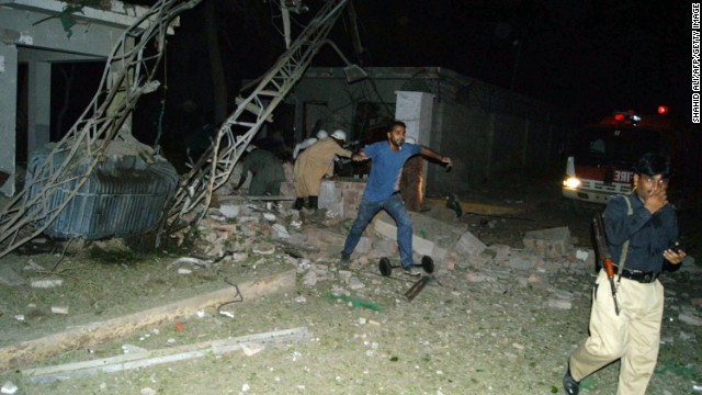 Pakistani security members are pictured at the site of suicide car bombing in the southern city of Sukkur on Wednesday.