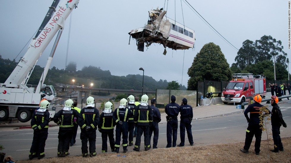 A train car is lifted Thursday, July 25, at Angrois near Santiago de Compostela, Spain. The train derailed as it hurtled around a curve at high speed on Wednesday, July 24.