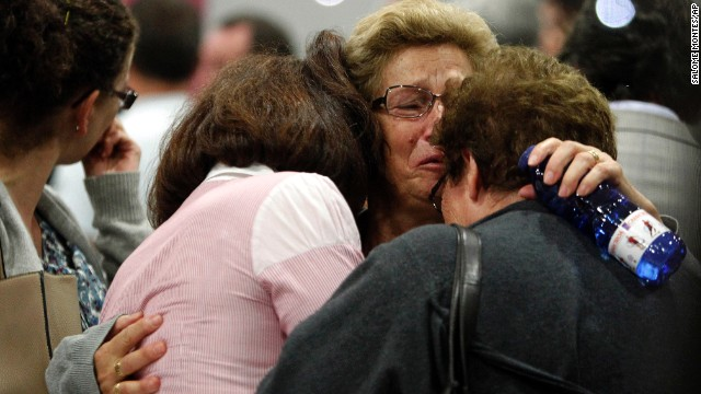 Women react as relatives of victims of a train accident wait for news while gathering at an area where information will be released in Santiago de Compostela, Spain, on Thursday, July 25, 2013. The death toll in a passenger train crash in northwestern Spain rose to 77 on Thursday after the train jumped the tracks on a curvy stretch just before arriving in the northwestern shrine city of Santiago de Compostela, a judicial official said.  (AP Photo/ Salome Montes)