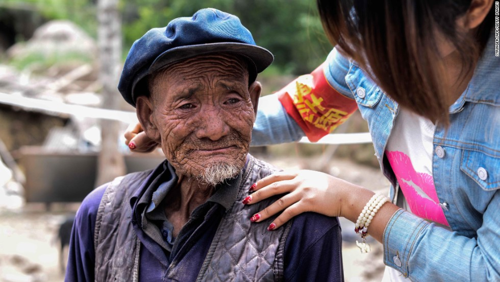 An elderly man weeps on July 24 after he hears he lost his grandson in the earthquake in Yongxing village.