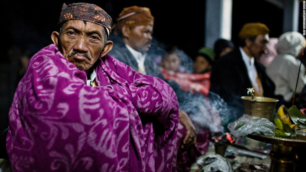 JULY 25 - PROBOLINGGO, INDONESIA: A shaman sits at a temple during the Yadnya Kasada celebration at crater of Mount Bromo in Indonesia. The festival is the main event of the Tenggerese people, a 600,000-strong isolated community living East-Central Java.
