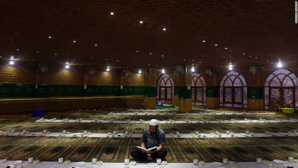 A Kashmiri Muslim man reads verses from the Quran in a mosque in Srinagar, India, on July 25.