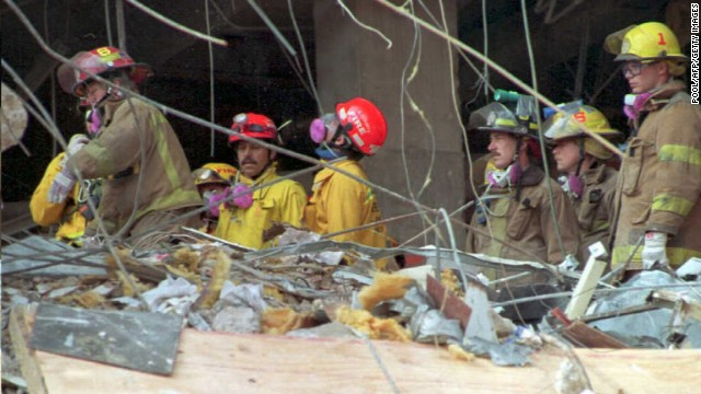 Emergency workers sift through the rubble of the Alfred P. Murrah Federal Building in downtown Oklahoma City, OK.