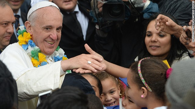 Pope Francis is surrounded by children at the Sao Jeromino Emiliani church during his visit to the Varginha favela in Rio de Janeiro, on July 25, 2013.