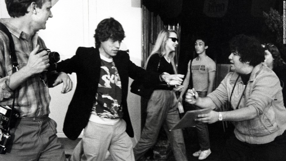 Mick Jagger and then-girlfriend Jerry Hall, center, attend an opening at the Mizuno Gallery in Los Angeles in 1983. Jagger and Hall were married for nine years starting in 1990.