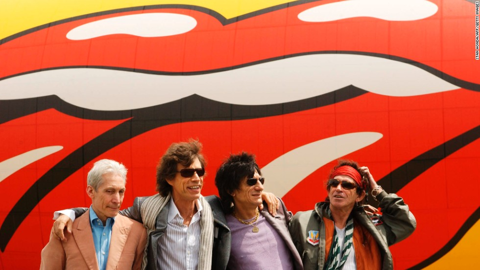 From left, Charlie Watts, Mick Jagger, Ron Wood and Keith Richards pose in front of a Rolling Stones blimp after arriving in New York in 2002.