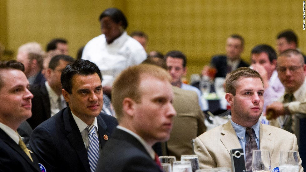 Yoder, second from left, sits in the audience and listens to another speaker. He assumed office in 2011, previously serving as a Kansas State Representative.