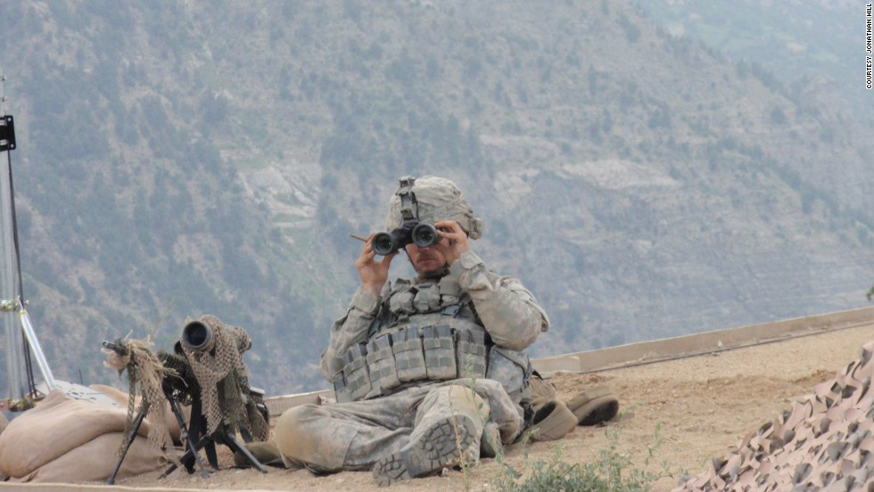 Carter on top of an Afghanistan Support Group (ASG) hut, providing eyes on an enemy attack and the approach/extraction route.