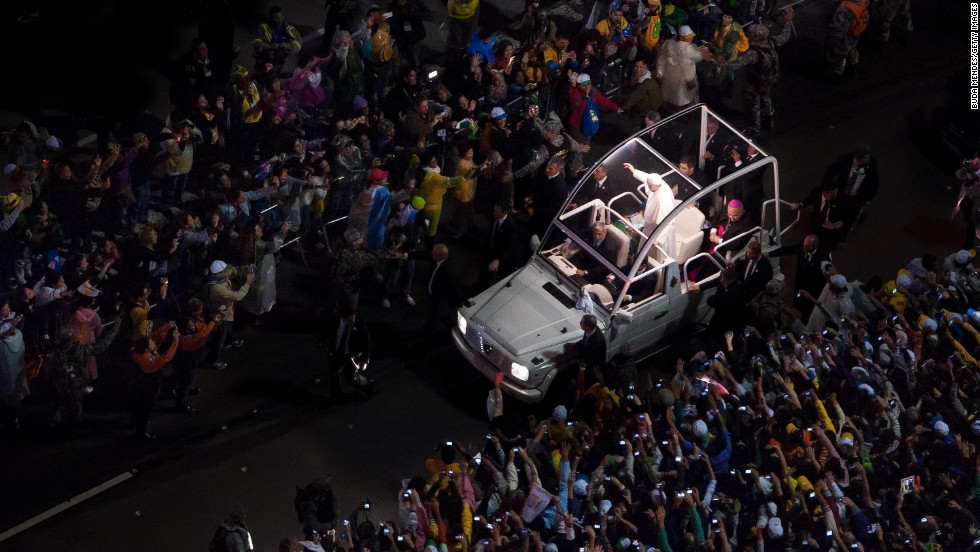 """JULY 26 - RIO DE JANEIRO, BRAZIL: Pope Francis arrives to celebrate Mass at Copacabana beach on July 25. The pontiff addressed <a href=""""http://religion.blogs.cnn.com/2013/07/25/in-address-to-youth-in-brazil-pope-francis-speaks-their-language/"""">about a million worshippers</a> at World Youth Day celebrations in Rio. His speech came at a time when <a href=""""http://cnn.com/2013/06/28/world/americas/brazil-protests-favelas"""">millions of Brazilians</a> have expressed discontent with their government."""