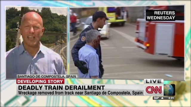 Police detain driver of derailed train