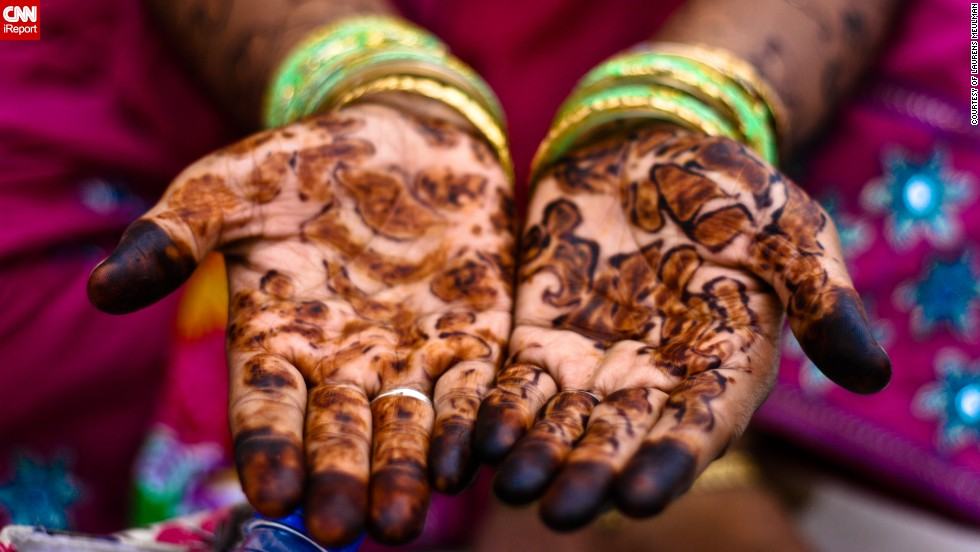 "During an Eid spent in India, Laurens Meulman, 35, from the Netherlands, spotted an irresistible photo-opportunity after she'd been invited to share food with a family in a square behind the Taj Mahal. ""The henna-painted hands of one of the women in the group caught my eye and I asked her if I could to take a photo,"" she said."