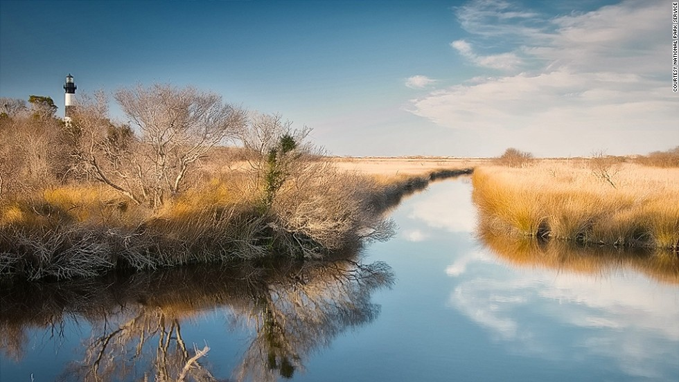 Bodie Island Lighthouse sits near freshwater marshland.