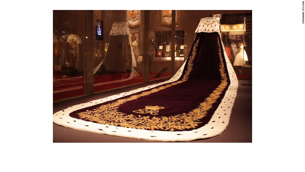 The tail of the purple velvet robe that the queen wore on her way to Buckingham Palace.
