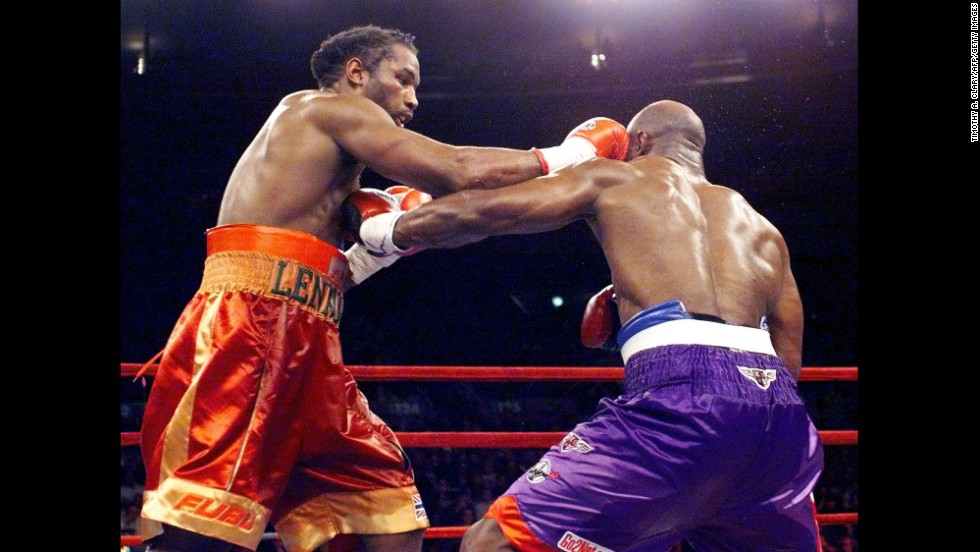 Evander Holyfield and Lennox Lewis fight their way to a draw in March 1999.