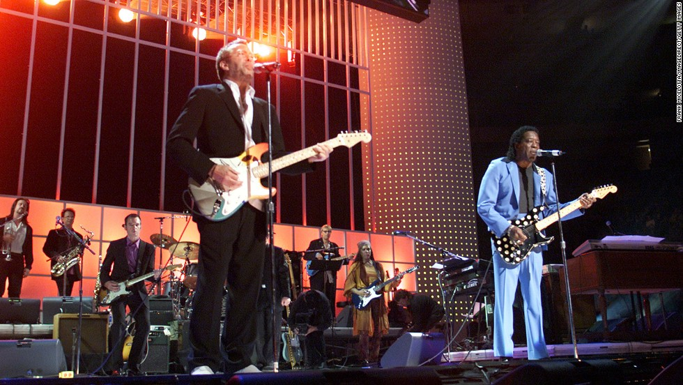 "Eric Clapton and Buddy Guy are among many performers who take the stage for ""The Concert for New York"" in October 2001."
