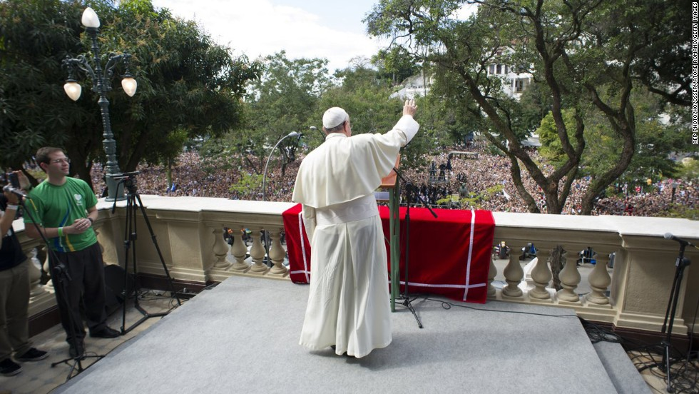 Pope Francis waves to the faithful from the balcony of St. Joaquim in Rio de Janeiro on July 26.
