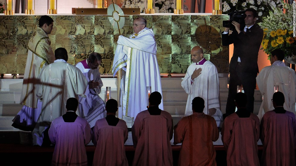 Pope Francis heads a prayer vigil with a reported 3 million Catholic pilgrims in attendance at Copacabana Beach in Rio de Janeiro on Saturday, July 27.