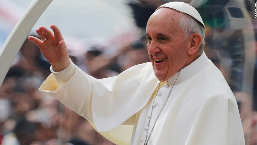 Pope Francis waves to the crowds on his way to Copacabana Beach on July 28.