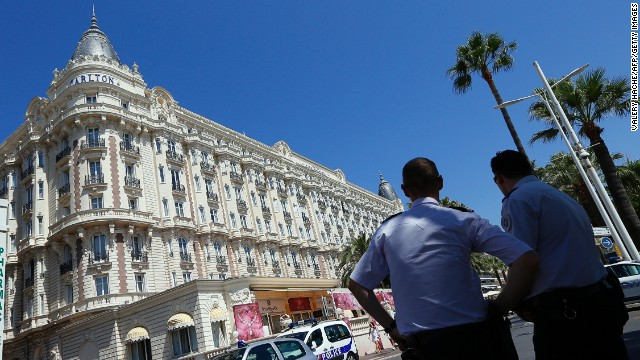 French policemen keep watch outside the Carlton Hotel in Cannes on July 28, 2013, after an armed man stole $53m of jewels.