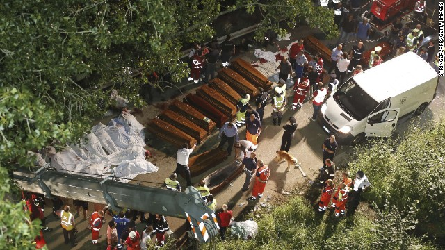 Rescuers prepare the coffins for victims of the crash on Sunday, July 28.