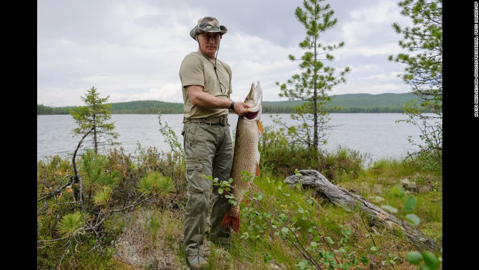 Putin holds a pike he caught in the Siberian Tuva region of Russia on July 20, 2013.