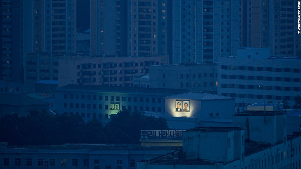 Portraits of former North Korean leaders Kim Il Sung and Kim Jong Il are displayed on Pyongyang buildings on July 27.