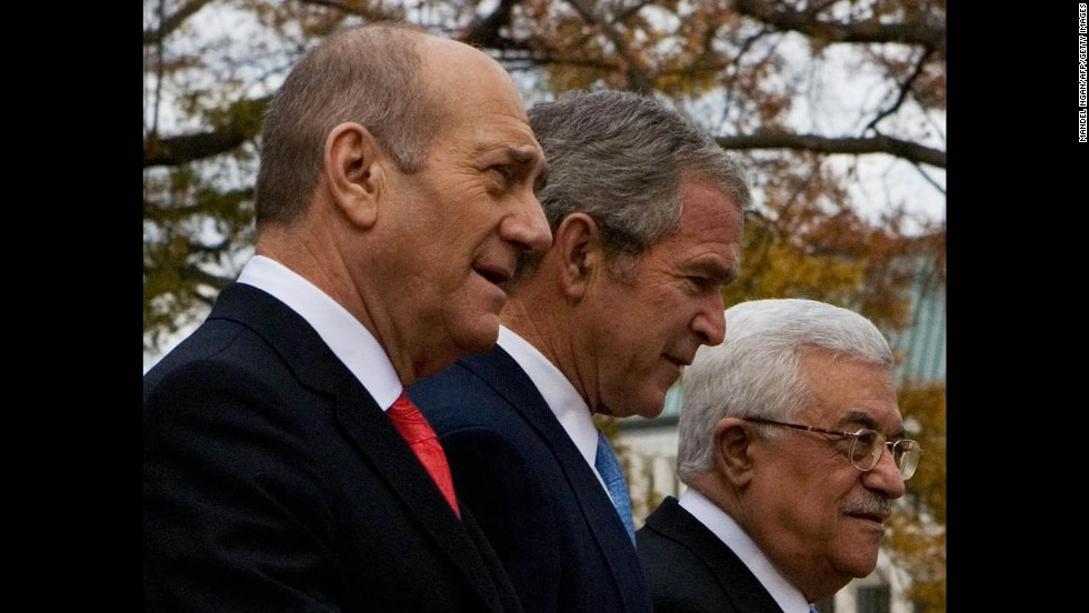 Then-President George W. Bush walks with then-Israeli Prime Minister Ehud Olmert, left, and Palestinian President Abbas on November 27, 2007, during the Annapolis Conference at the U.S. Naval Academy in Maryland. The peace conference was attended by 16 Arab countries, including Saudi Arabia and Syria, Israel and the Palestinians. A joint statement was the only thing agreed upon under heavy American pressure and by avoiding specific reference to any of the core issues.