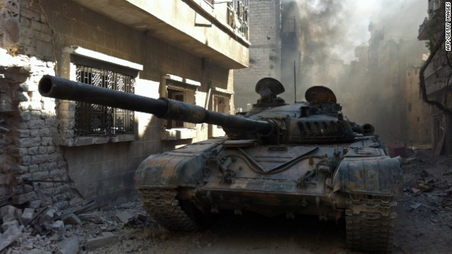 A government forces tank is seen in the Khalidiyah neighbourhood of Syria's central city of Homs on July 28, 2013.