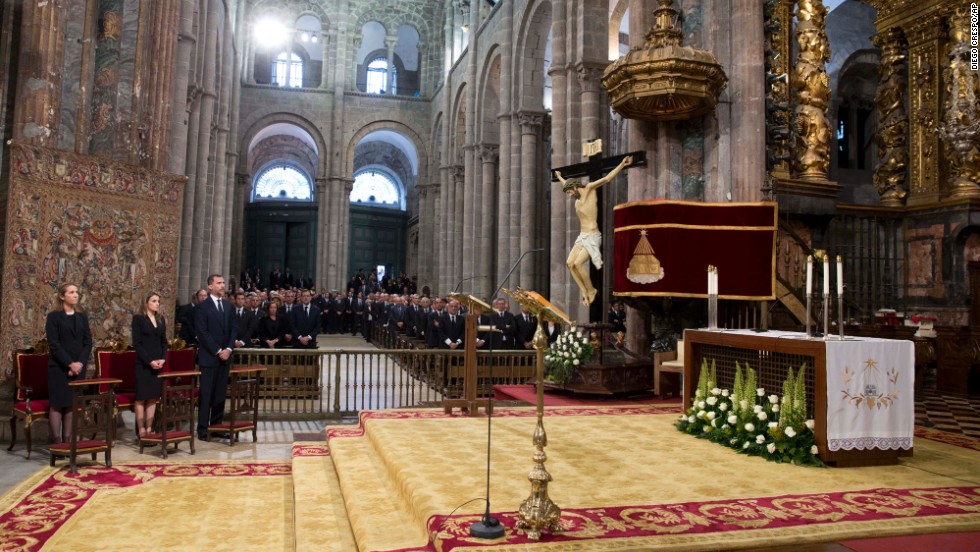 "Spain's Princess Elena, left, Princess Letizia and Prince Felipe attend <a href=""http://www.cnn.com/2013/07/29/world/europe/spain-train-crash/index.html"">a funeral Mass for the victims of a train</a> derailment at a cathedral in Santiago de Compostela on Monday July 29. At least 79 people have been confirmed dead in the July 24 crash in northwest Spain."
