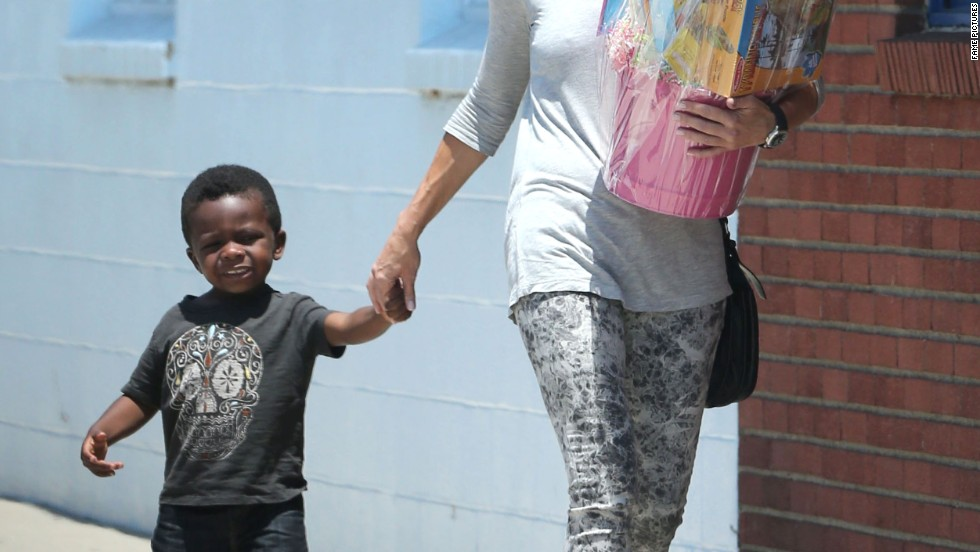 Sandra Bullock and her son Louis are ready to party on July 28.