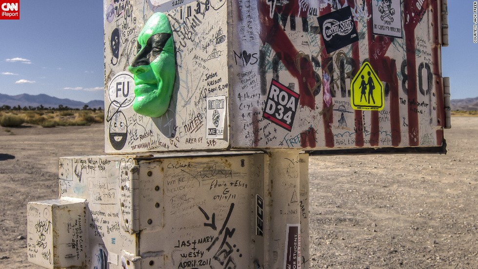 "<a href=""http://ireport.cnn.com/docs/DOC-1012300"">This interesting mailbox</a> marks the dirt road that presumably leads to the legendary Area 51. Throughout the years, tourists and alien-seekers have decorated it with stickers, graffiti and even a green face."