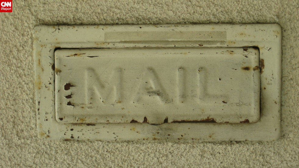 "Kathi Cordsen doesn't have a mailbox, but she does have a <a href=""http://ireport.cnn.com/docs/DOC-1012115"">doorside letter slot</a>, one she likes for its rustic appearance. Under Rep. Darrell  Issa's proposal, the Postal Service would cease all individualized mailbox delivery."